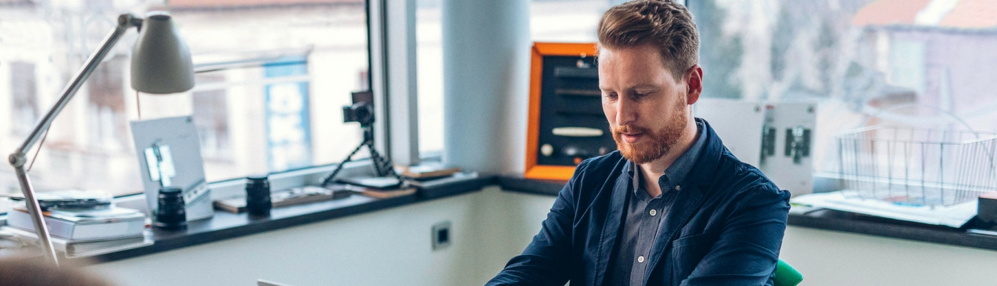 Office employees working at stylish and personalized desk