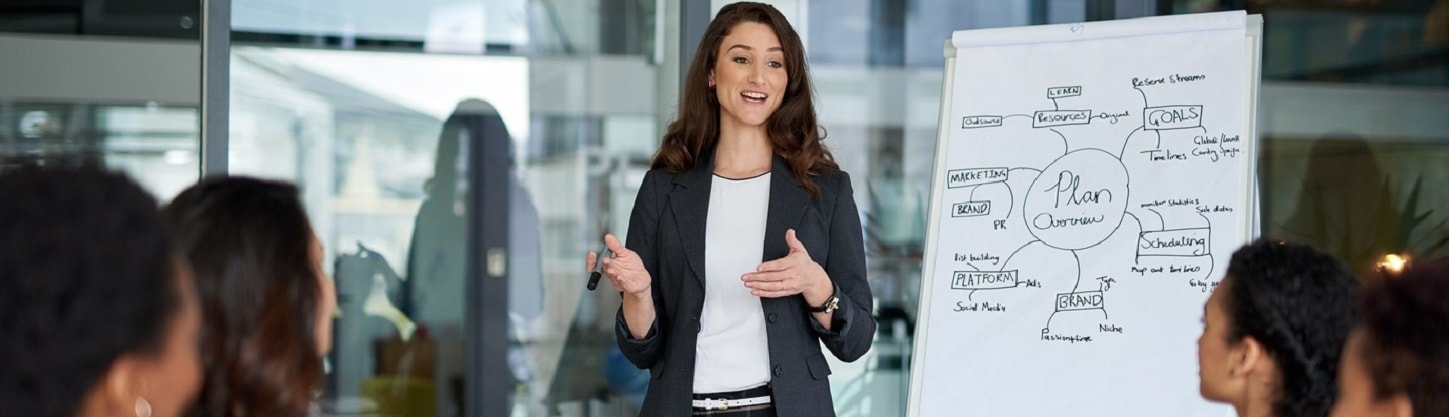 A woman presenting at a business