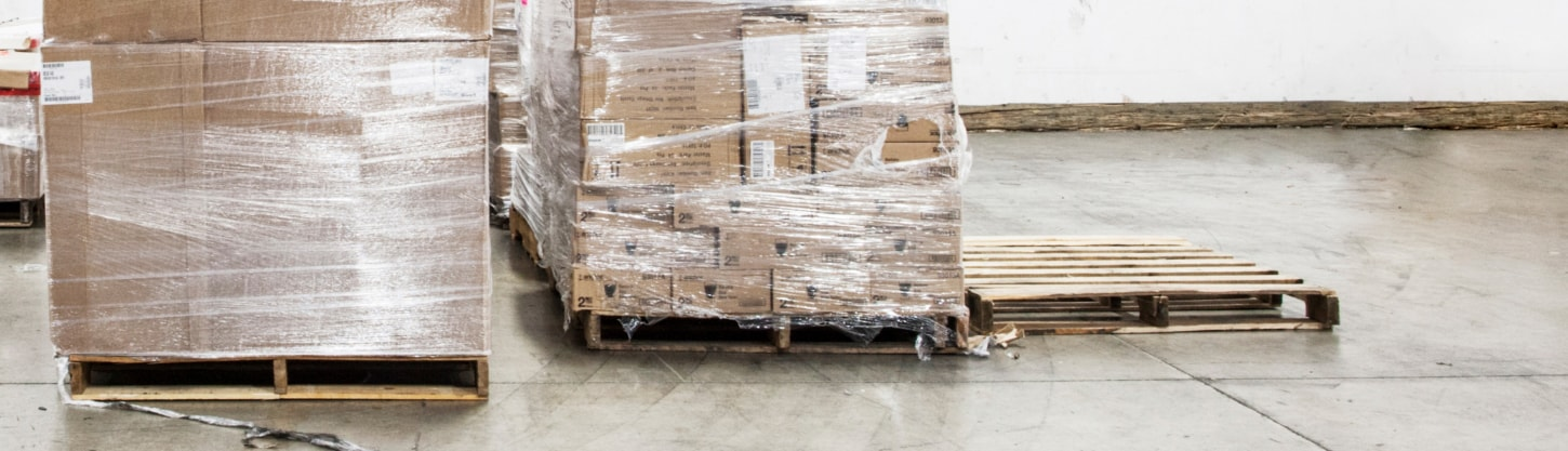 plastic wrapped boxes in warehouse