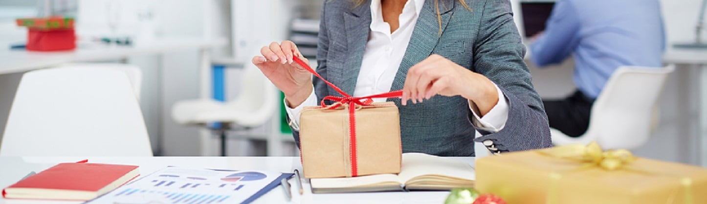 A procurement professional providing a gift