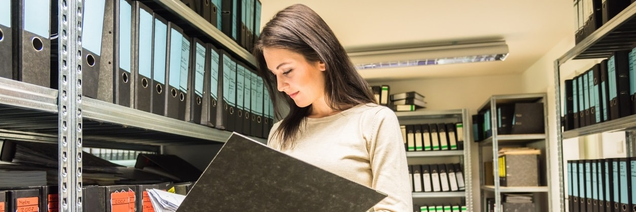 An office worker reviewing document storage
